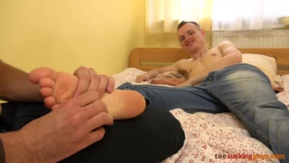guy in jeans gets foot massage and more