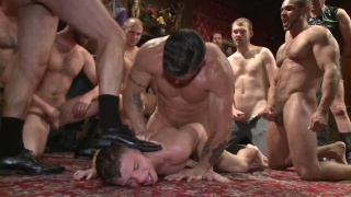 hung stud passed around a bar and gang fucked