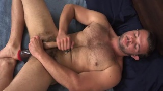 sexy brady shoves a giant dildo in his ass
