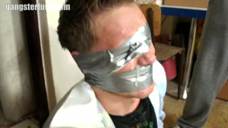 nasty gangster duct tapes a blond guy