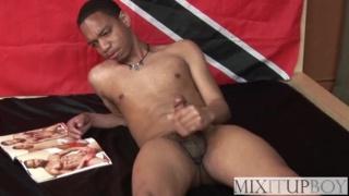 black dude jacks off to porno mag