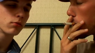 two buddies swap mouthfuls of smoke