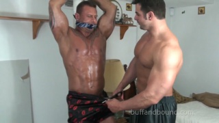 muscular bodybuilder gagged and bound for tickling