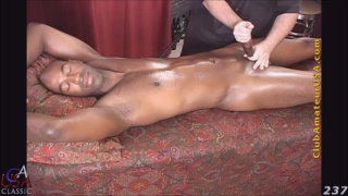 chocolate stud gets massage table handjob