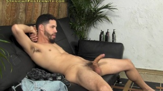 bearded dude strokes his uncut cock