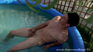 sexy guy Andre Otam jerks off in pool
