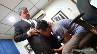 asian lad takes the boss' cock up his ass
