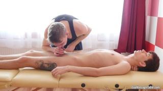 masseur ass fucks his client on massage table