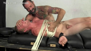 blond guy howls during his naked tickling session