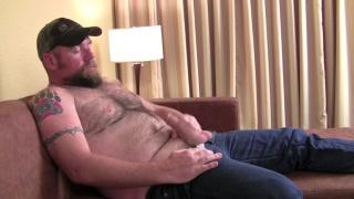 Justin strokes his cock