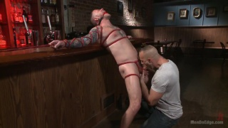 max cameron tied up and edged in a bar