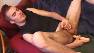 jasper shoves a long dildo up his bum