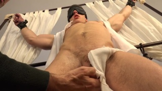 sexy euro stud restrained for cock edging session