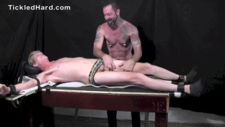 handsome 25-year-old blond howls during tickling session