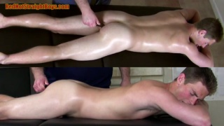 lad fucked with vibrating dildo on massage table