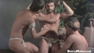 two roman slaves suck and jack Demetrius off