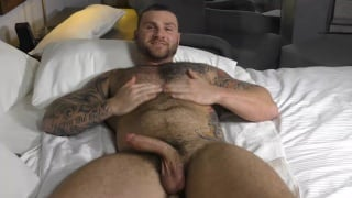 tattooed hairy muscle hunk jerks his cock