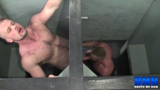 muscle hunk fucks bare ass through gloryhole