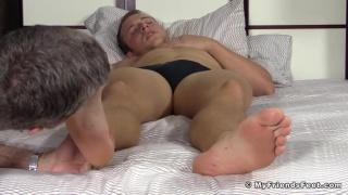 worshipping a sleepy hunk's bare feet