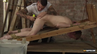 twink tied to a ladder and dildo fucked
