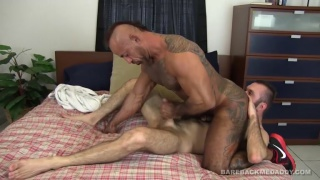 inked daddy fucks bearded bottom's ass