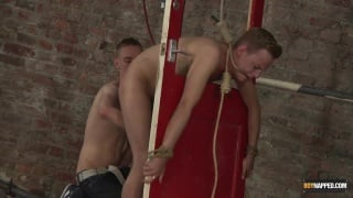 blond sex slave tied up and flogged