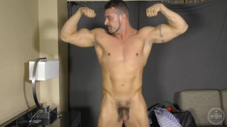 tank flexes his biceps and strokes his dick