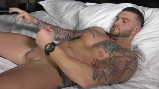beefy inked dude chris jacks his 9-inch cock