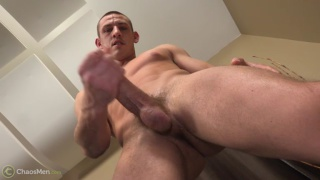 rough-looking guy strokes his 9-inch dick