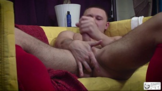 stud in jockstrap and socks jacking off