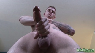 inked duty strokes his very big cock