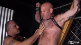 bald daddy tied to a cross and used