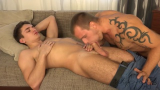 guy in jeans gets blowjob from inked stud