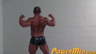 massive young protein puppy flexes and pumps
