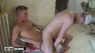 twink sits on construction worker's bare dick