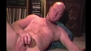 bearded ginger plays with his cock