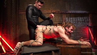 tied to a cross and blindfolded, connor patricks waits ...