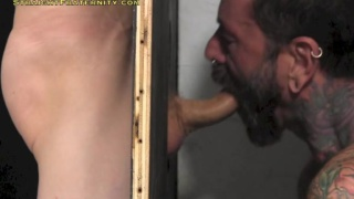 glory hole cocksucker takes his turn getting blown