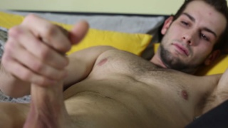 scruffy-faced stripper strokes his uncut cock
