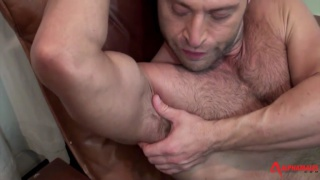 JR Bronson flexes his muscles during jack-off video