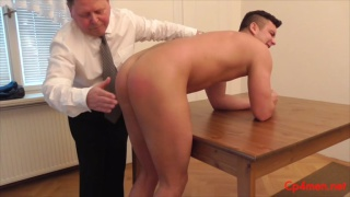 greg bends over dining table for a spanking