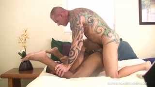 inked daddy Blade Hunter breeds his boy's ass