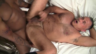 silver daddy takes a big black cock up his ass