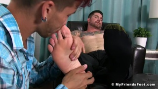 Justin Case worships clint's bare feet