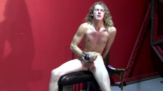 long-haired ryann ruckers jerks his cock