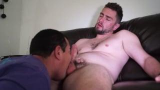 Beefy guy gets teased on bed