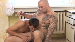 inked bald muscle top fucks young lad's ass