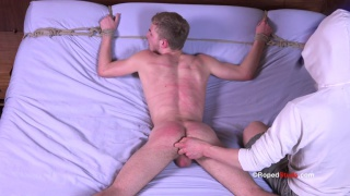 logan tied down and dildo fucked