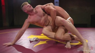 Bound and gagged, wrestler takes a huge dildo up his ass