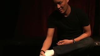 max rubs his sore feet in white socks